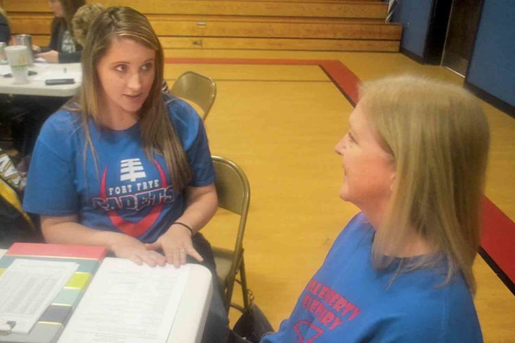 Second-grade teachers Sara Marshall, of Lowell, and Lisa Blain, of Lower Salem, role play during the Signs of Suicide program at Beverly-Center Elementary School on Tuesday. (Photo by Peyton Neely)