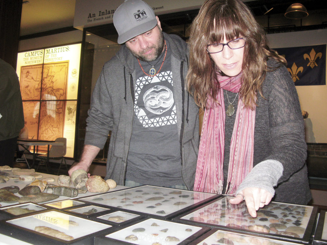Photo by Jeffrey Saulton Aaron Ferguson, left, and Anne Glass, right, both of Athens, Ohio, look over an arrowhead collection at Campus Martius Museum on Saturday.