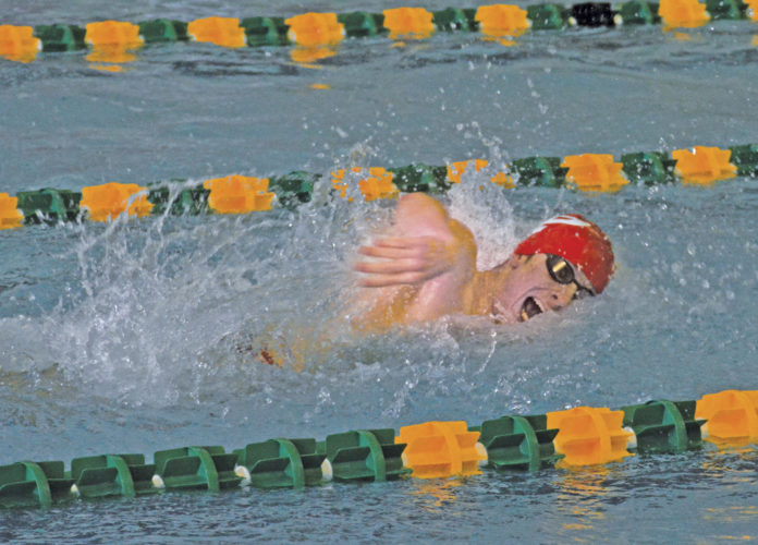 Parkerbsurg Nathan Burd swims in a relay during the Region I meet Saturday in Wheeling. Burd won gold in the 100 and second in the 50 freestyle. Photo submitted.