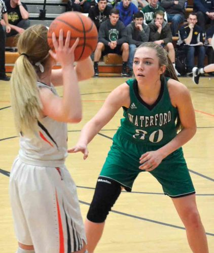 Photo by Ron Johnston Waterford's Alli Kern, right, guards Belpre's Cheyenne Barker during a high school girls basketball game Monday night. Waterford won, 63-23.