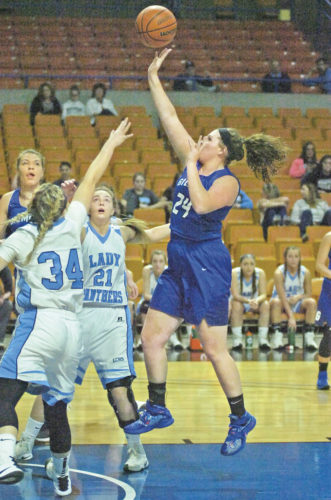Gilmer County's Carly Somerville flies through the air shooting the basketball while guarded by Lincoln County's Alli Farmer (34) and Rachel Pennington (21) during the Titans' 53-31 win over the Panthers Tuesday at the Little General Shootout at the Big House inside the Charleston Civic Center. Photo by Joe Albright.