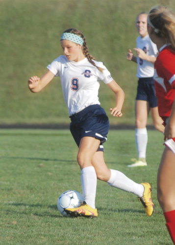 Parkesburg South's Cassie Whitlatch dribbles the ball down the field against Wheeling Park offensive players during a 2016 regular season game with the Patriots. Whitlatch signed on the dotted line to play soccer at Fairmont State for the next four years Thursday. Photo by Joe Albright.