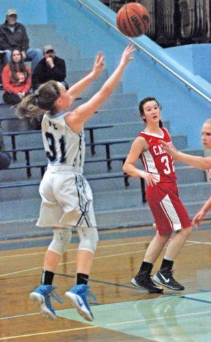 Parkersburg Catholic's Madeline Huffman (31) shoots against Calhoun County's Kaylea Bennett during a high school basketball game Thursday. Photo by Steve Hemmelgarn.