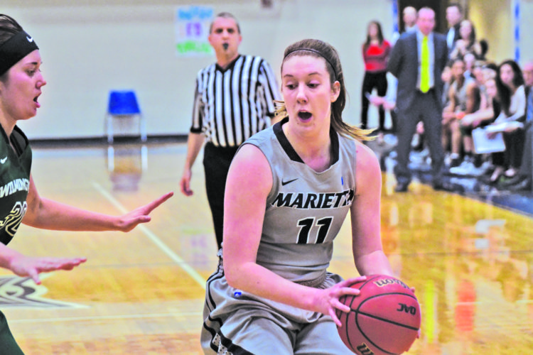 Marietta College's Alexis Enochs makes a move with the ball during a college women's basketball game against Wilmington Saturday at Ban Johnson Arena. Photo courtesy of Evan Odom.