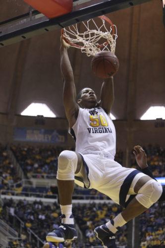 West Virginia forward Sagaba Konate (50) dunks the ball during the second half of an NCAA college basketball game against Kansas State, Saturday, Feb. 11, 2017, in Morgantown, W.Va. West Virginia won 85-66 (AP Photo).