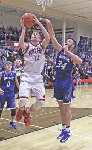 Fort Frye's Jacob Prichard (24) attempts to shoot as Buckeye Trail's Jacob Doudna (34) defends during a high school basketball game Tuesday. Photo by Tom Perry.