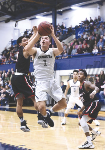 Marietta College's Dillon Young (1) goes up for a basket during a college men's basketball game against Muskingum Wednesday night at Ban Johnson Arena.