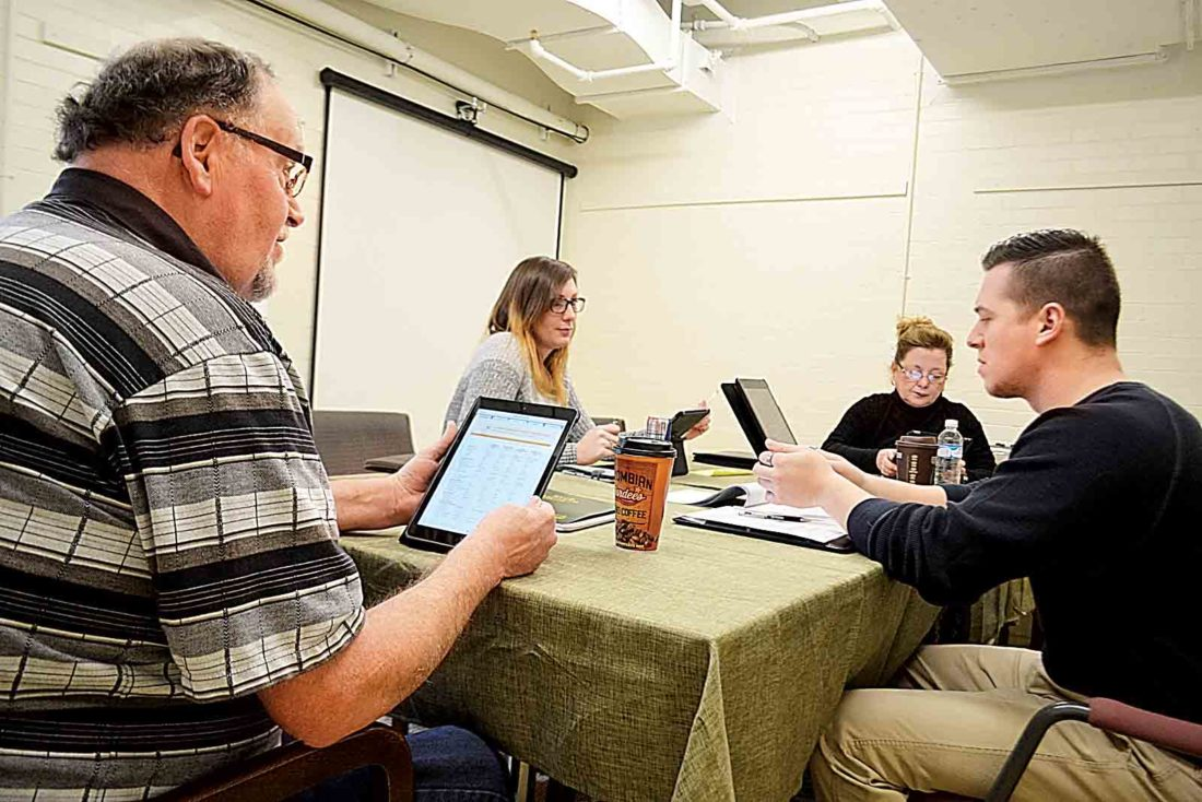 Photo by Peyton Neely Employees of Combined Insurance work together during a business meeting at the Epicenter on the bottom floor of the Armory on Front Street.
