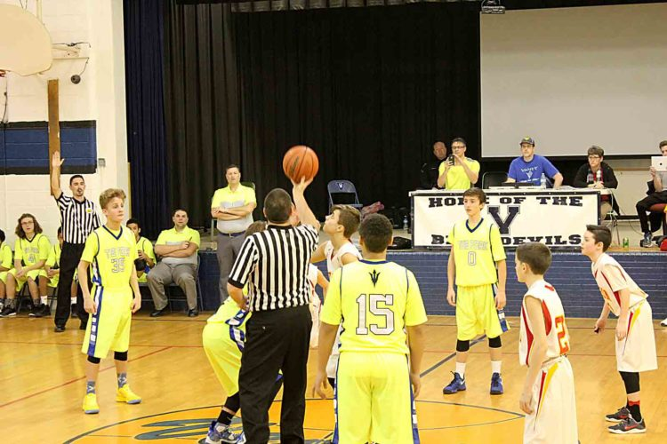 Photo Provided Jake Leisure of VanDevender Middle School and Landon Francisco of Edison Middle School prepare for the tip off of the inaugural Lemonade Stand Game on Tuesday to raise money into childhood cancer research.
