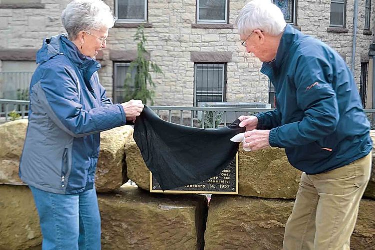 Photo by Peyton Neely Nellie Beardmore and her brother, Bill Hess, both of Marietta, unveil the plaque that honors their late uncle, Dean Hess, at the Memorial Garden beside the First Presbyterian Church on Tuesday afternoon.