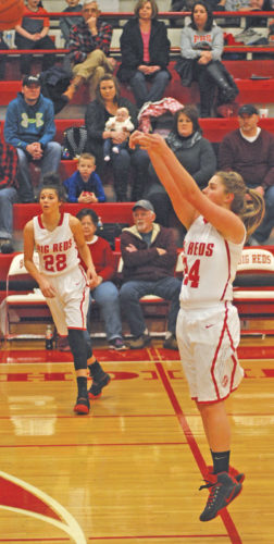 Parkersburg's Alex Delozier shoots a 3-pointer while Big Red teammate Shay-Lee Kirby looks on during a game earlier this season. The Big Reds will take on Huntington tonight at the South Charleston Community Center in the Mountain State Athletic Conference championship game. Tip is scheduled for 6 p.m. Photo by Jay W. Bennett.