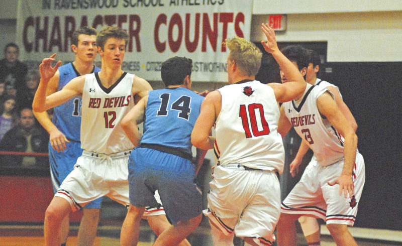 Parkersburg Catholic's Logan Plummer (14) tries to drive against the defense of Ravenswood's Riley Heatherington (12), Jayden Rhodes (10) and Stephen Dawson (23) in a game earlier this year. The third-ranked Class A Red Devils take on No. 5 Gilmer County at 8 p.m. today inside Glenville State College's Waco Center in the Little Kanawha Conference's Night of Champions title game. Photo by Jay W. Bennett.