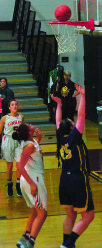 Photo by Steve Hemmelgarn Belpre's Kyna Waderker and Southern's Faith Teaford look to collect a rebound during the Golden Eagles' 42-34 win over the TornadoesSaturday.