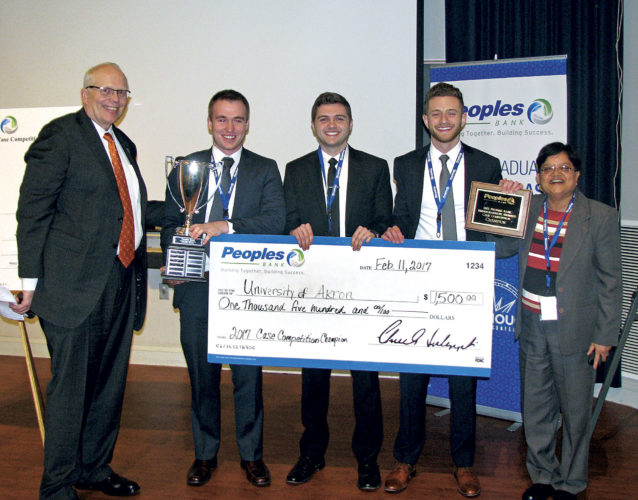 Photo Provided The University of Akron Team took first place in the 5th annual Peoples Bank Business Case Competition on Feb. 11. From left, Chuck Sulerzyski (Peoples Bank CEO and President), Layne Scheufler (University of Akron student), Preston Matos (University of Akron student), Eric Vlahos (University of Akron student) and Bhanu Balasubramnian (University of Akron team adviser.)