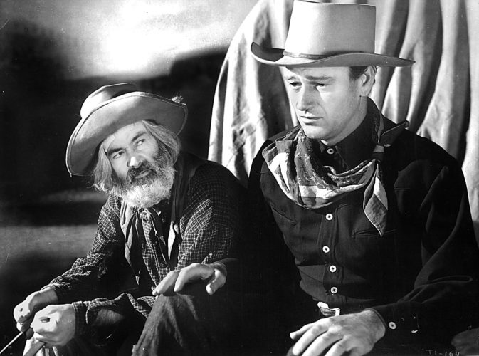 "Photo Provided Gabby Hayes and John Wayne in ""Tall in the Saddle."""