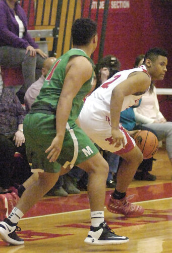 Photo by Joe Albright  Parkersburg's Easton Martin works against Mussleman's Latrell Warr during the Applemen's 57-56 win over the Big Reds Monday night inside PHS Memorial Fieldhouse.