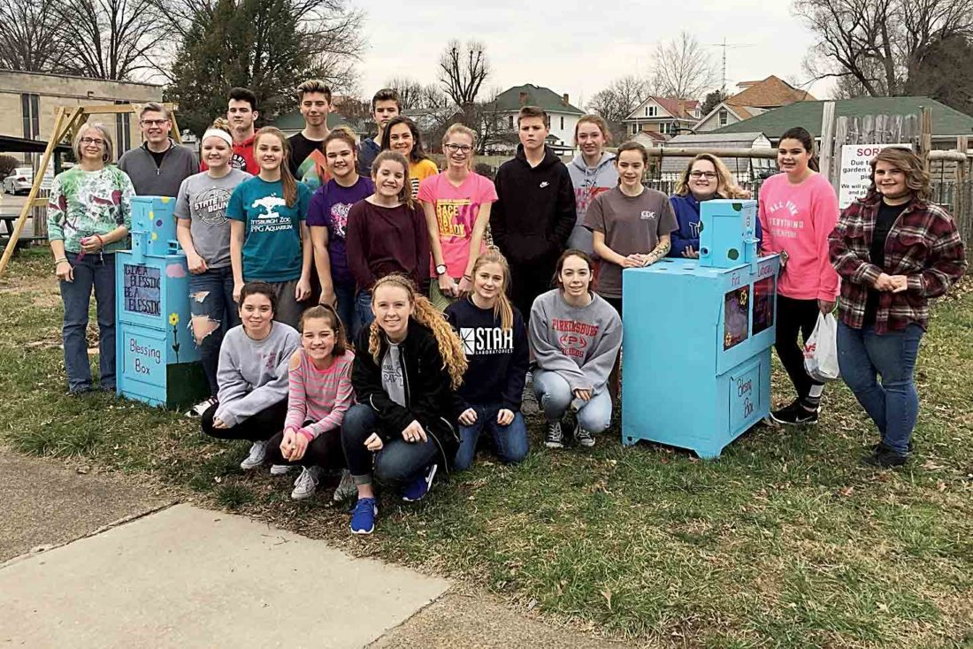 Youth at the First Lutheran Church in Parkersburg who participated in the 30-hour famine painted, decorated and filled the new blessing boxes containing items for those in need in the community. (Photo Provided)
