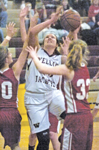Williamstown's Brooke Stewart concentrates while trying to get a shot off surrounded by Calhoun County player's during the Yellowjackets' 96-51 win over the Red Devils Tuesday. Photo by Joe Albright.