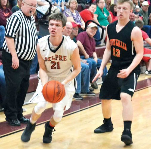 Belpre's Mythius Houghton (21) makes a move with the ball as South Gallia's Caleb Henry looks on during a sectional semifinal boys basketball game Wednesday night in Pomeroy, Ohio. Photo by Ron Johnston.