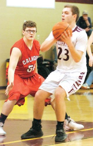 Williamstown's Josh Folwell, right, looks to pass as Calhoun County's Hayden Richards defends during a high school boys basketball game Wednesday night. Photo by Steve Hemmelgarn.
