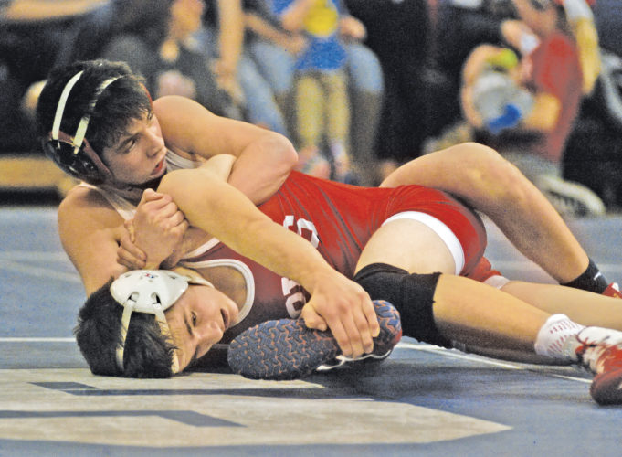 Parkersburg South's Ian Irizarry, top, and Parkersburg's Hunter Ackerman will begin their run in the Class AAA 113-pound weight class starting tonight at the West Virginia state wrestling tournament held inside Huntington's Big Sandy Superstore Arena. Photo by Jay W. Bennett.