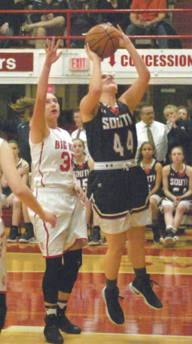 Parkersburg's Madi Mace (35) attempts to block a shot by Parkersburg South's Allie Taylor during a high school basketball game earlier this season. Photo by Joe Albright.