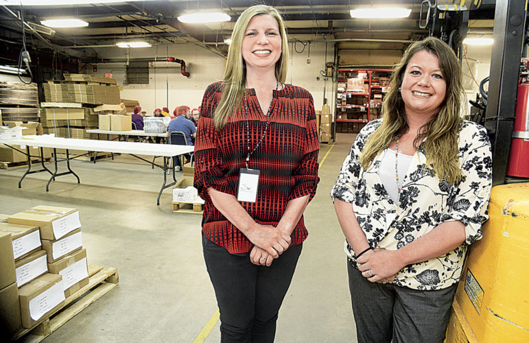 Photo by Jeff Baughan Terah Klein, left, president and chief executive officer at SW Resources, and Annetta Douglas, sales and marketing manager at SW Resources, stand in the warehouse at SW Resources. Both said United Way funds provide for job and vocational rehabilitation of clients.