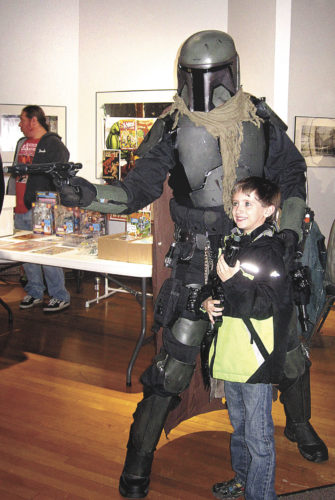 """File Photo Abram Hadfield, 7, of Parkersburg, get his picture taken with a """"Star Wars"""" character at last year's Classic Plastics Toy and Comic Expo at the Parkersburg Art Center. This year's expo will be March 4-5 at the art center in downtown Parkersburg."""