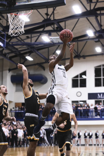 Marietta College's Keith Richardson goes in for a layup during an OAC tournament match against Baldwin Wallace Saturday at the Ban Johnson Arena.