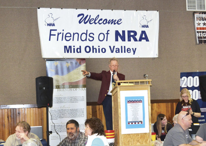 Photo by Doug Loyer David Graham, NRA Southern Ohio Field Representative, announces some winners at the Friends of NRA Banquet on Saturday.