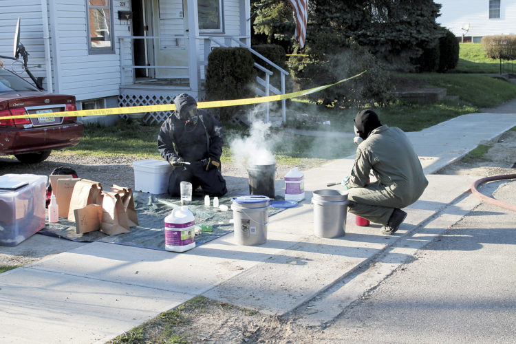 Photo submitted by Washington County Sheriff's Lt. Josh Staats Members of the Washington Morgan Noble Major Crimes Task Force neutralize lithium from a methamphetamine lab in 2016.