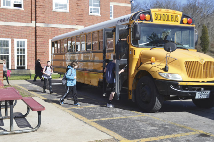 Photo by Peyton Neely Students board a bus at Marietta Middle School after classes Friday afternoon.