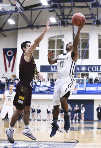 Marietta College's Keith Richardson (11) shoots during a college basketball game against Calvin College Friday at  Ban Johnson Arena. Photo courtesy of Nate Knobel.