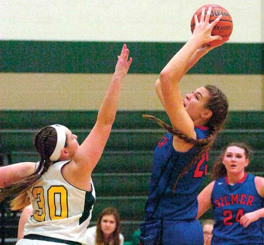 Gilmer County's Riley Fitzwater, right, attempts a jumper during a high school girls basketball game against Doddridge County earlier this season in West Union.   Photo by Joe Albright