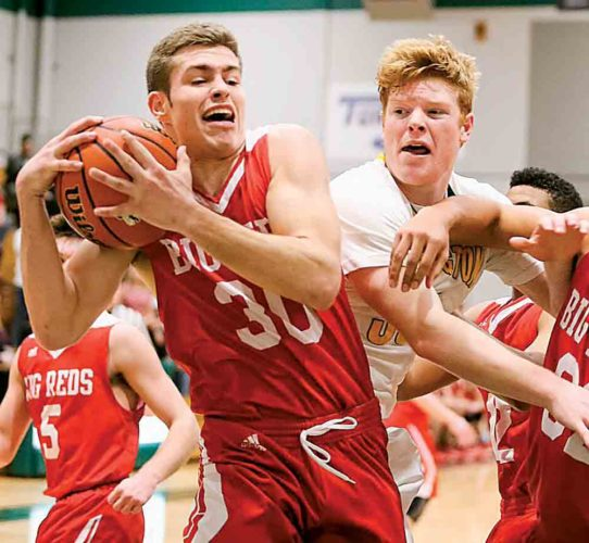 Photo courtesy of Sholten Singer Parkersburg High's Karson Snyder (30) drives with the ball during Tuesday's Class AAA, Region IV co-final at Huntington High School.
