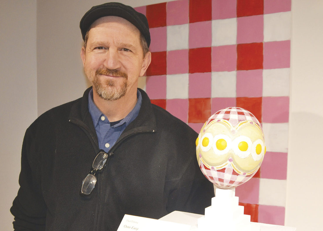 """Photo by Brett Dunlap """"Over Easy"""" by Paul Emory of Zanesville is one of the ostrich eggs used as the """"canvas"""" for artists to  create unique works of art in the """"Art 360: Contemporary Art Hatching Across Ohio"""" exhibit on display at the Parkersburg Art Center."""