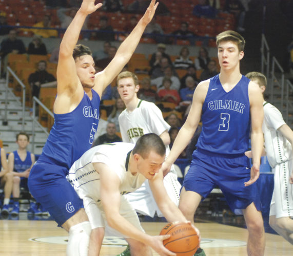 Gilmer County's Noah Aviles, left, and Trey Shuff, right, try to trap Notre Dame's Jaret Mullooly during Wednesday's Class A state quarterfinal at the Charleston Civic Center. Photo by Jordan Holland.