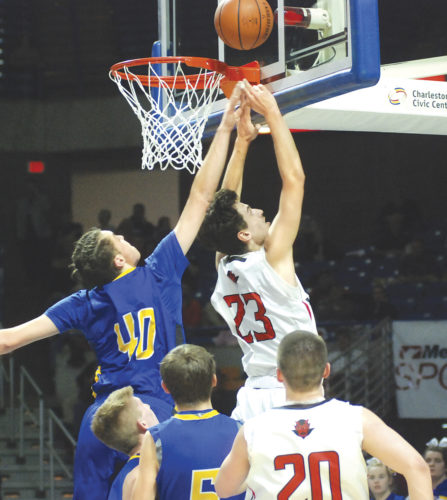 Ravenswood's Stephen Dawson (23) attempts to get a bucket as St. Joseph Central's Gabe Giampalo (40) tries to block it during Wednesday's Class A state quarterfinal matchup at the Charleston Civic Center. Photo by Jordan Holland.