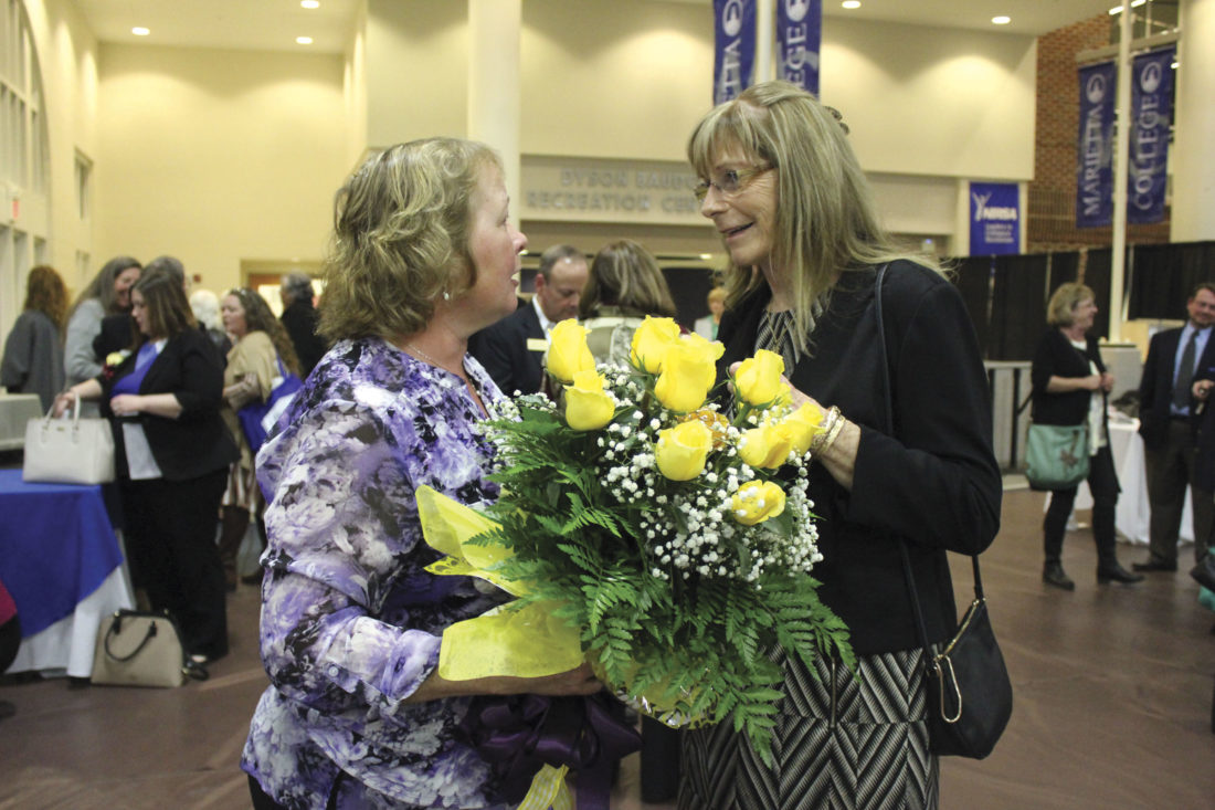 """Photo by Janelle Patterson Laurie Strahler, right, congratulates Christine Cavalier, left, for being recognized as the 2017 Elizabeth """"Betty"""" A. Hadler Zonta Woman of the Year."""