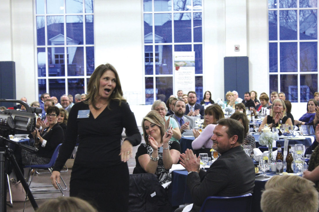 Photo by Janelle Patterson Laura Miller is surprised to be selected as the 2017 Marietta Area Chamber of Commerce Ambassador of the Year.