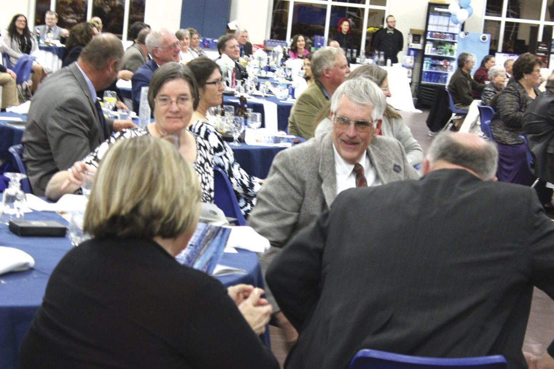 Photo by Janelle Patterson Dr. Phil Lowe realizes he was selected for the 2017 Washington County Council of Cooperatives Agricultural Award at the dinner.