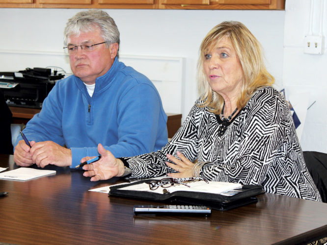 Photo Provided From left, Bob Rauch, chairman of the Belpre Area Chamber of Commerce Economic Development Committee, and Kathleen Young, a liaison for the governor of Ohio, at a committee meeting on Wednesday.