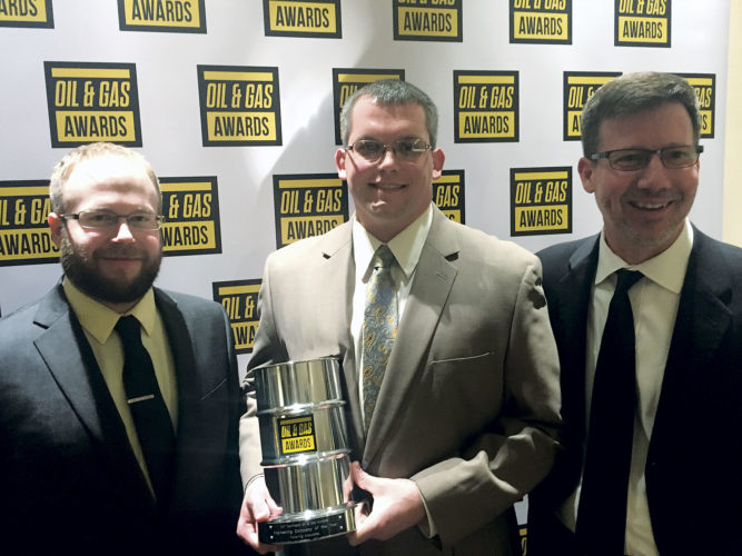 Photo courtesy of Pickering Associates From left, Pickering Associates engineers John Bentz and Mark Welch and professional surveyor Bill Showalter are shown with the company's Engineering Company of the Year award at the 2017 Northeast Oil and Gas Awards Gala Dinner on March 2 in Pittsburgh.