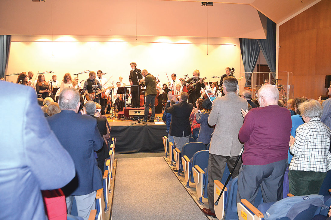 Photo by Brett Dunlap Grant Cooper, conductor and Artistic Director of the West Virginia Symphony, gets a standing ovation from those in attendance at his final concert at Blennerhassett School on Sunday.