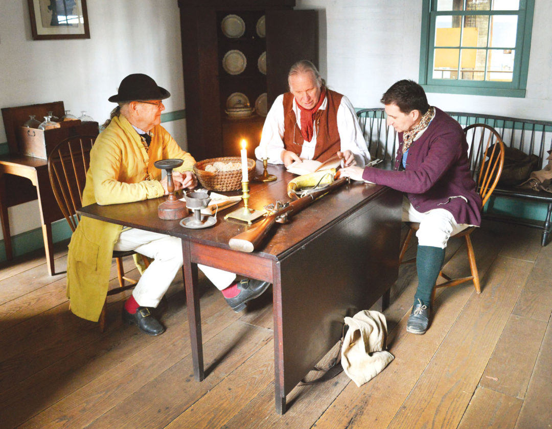 Photo by Doug Loyer John Conklin, from left, Bill Reynolds and Rob Gorrell re-enact a meeting from 1791 as Winthrop Sargent, Rufus Putnam and an Ohio Co. Director.