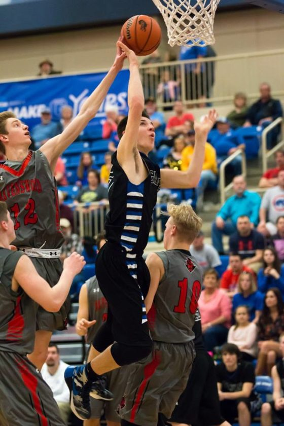 Photo by Amy Springer Gilmer's Trey Shuff goes up for two points against Ravenswood during the LKC Championship game.