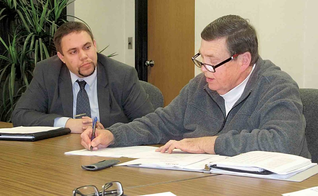 Parkersburg Development Director Rickie Yeager, left, listens as Councilman Dave McCrady asks a question during Monday's Personnel Committee meeting at the Municipal Building. (Photo by Evan Bevins)