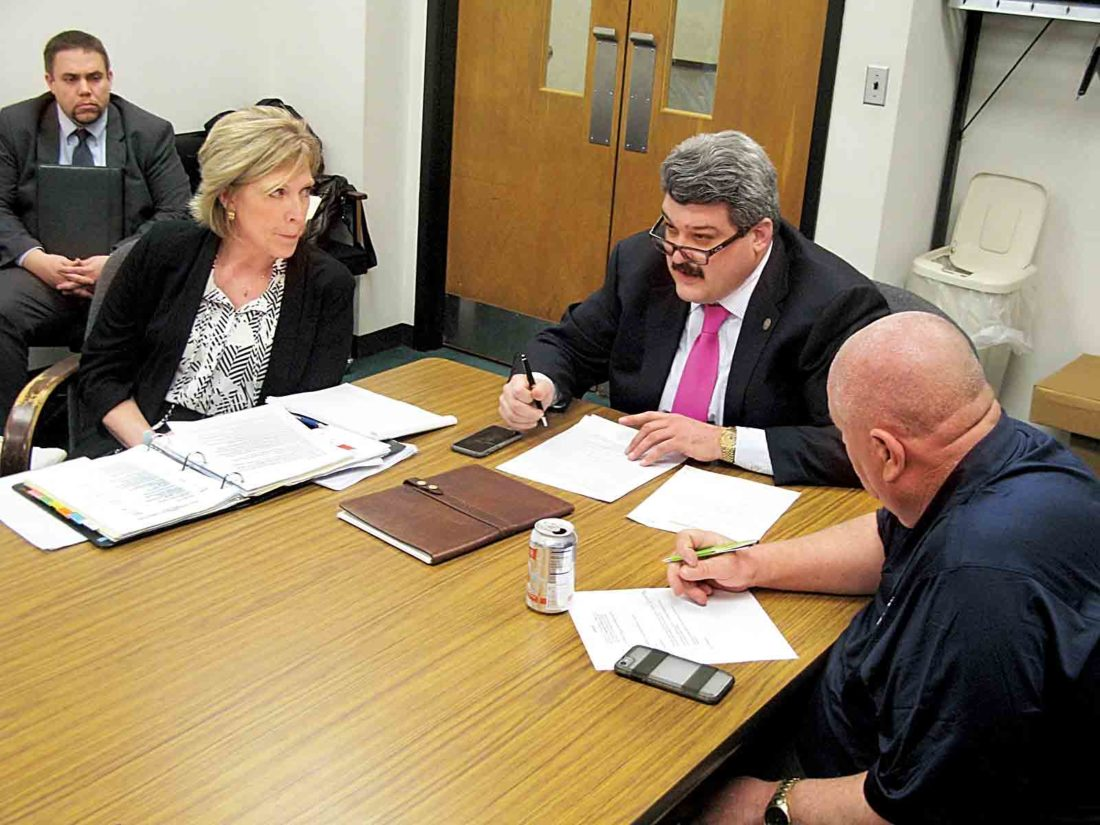 Parkersburg Mayor Tom Joyce, second from right, speaks during Monday's City Council Personnel Committee meeting as, from left, Development Director Rickie Yeager, Personnel Director Sondra Wallace and Public Works Director Everett Shears listen. (Photo by Evan Bevins)