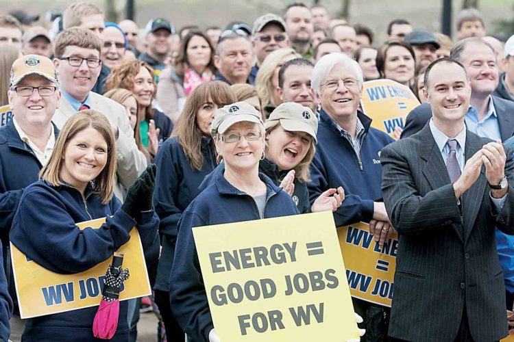 Keith  Burdette, at right, a former commerce secretary in West Virginia, with Cam Huffman, a former director of the Wood County Development Authority, next to Burdette, attend the West Virginia Jobs and Energy Rally Tuesday morning at the Capitol. The crowd wants legislation creating jobs in oil and gas and promoting economic development. (Photo Provided)