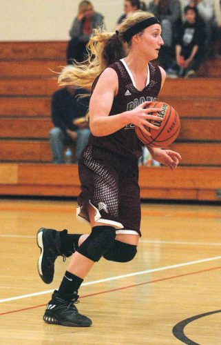 Roane County junior Lucille Westfall, pictured here during the Raiders' season-opening win at Wirt County, became just the second player in school history and the first since Shandi White in 2004-05 to earn first-team Class AA all-state honors by the West Virginia Sports Writers Association.  Photo by  Jay W. Bennett